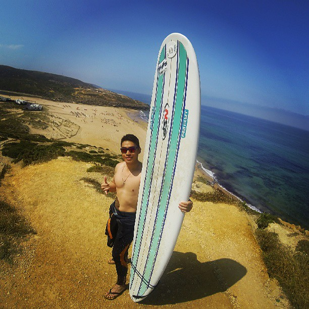 Looking badass with my surfboard in Portugal!